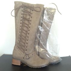 BRAND NEW Gray/Brown Leather Boots Brand new muted tan leather boots with original plastic and packaging. Never worn.   💫🚚Fast Shipper🚚💫 💰🔨Negotiable 🔨💰 👸🏼👧🏽Ask us any questions you have about any items🗣🗣 🎁🎀Willing to do custom bundles🎀🎁 Colin Stuart Shoes Lace Up Boots
