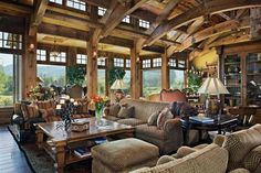 I love great rooms in houses. These are large, open concept living spaces that are on the grand side of design. This is our epic great room design collection. Cabin Homes, Log Homes, Family Room, Home And Family, Timber Frame Homes, Floor To Ceiling Windows, Tall Ceilings, Big Windows, Wood Ceilings