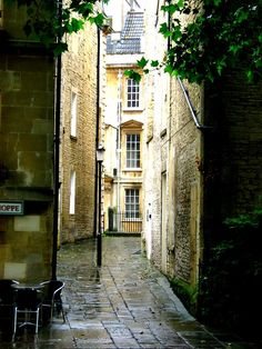 Bath, UK. Listened to a bard sing in a greenery square. Heard violin music from windows above. The whole place was magic.