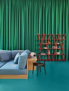 Kvadrat textiles clads the back wall of the installation Cassina 9.0, a celebration of the 90th anniversary of Cassina.