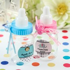 Each clear plastic bottle comes with a screw-on cap in the color of your choice, complete with a white nipple. A color-coordinated pacifier charm is attached to the top with a beautiful satin ribbon. Simply fill the bottle with your favorite sweet treats and trinkets for a gift your guests can take home and treasure. Bottles come with personalized self-sticking labels in a variety of color combinations, themes, and styles.  #timelesstreasure,
