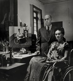 Frida Kahlo with her surgeon, Doctor Juan Farill, and her painting of them, photographed by Gisèle Freund, 1951.