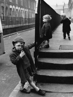 Young Boys Play on the Street - Salford Manchester 1964  by Shirley Baker