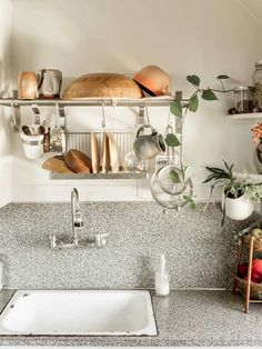 Drying rack above sink -- great idea for saving counter space.