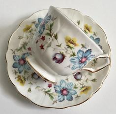Vintage Aynsley china tea cup and saucer, made in England. A white ground in the crocus shape with wild flowers. It is in good condition, no chips, cracks or crazing. Please Note: The items I sell are not new, they are vintage or antiques, it goes without saying that there