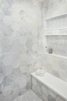 Stunning walk-in shower boasting large marble hexagon wall tiles with a white quartz bench. Large Tile Bathroom, Hexagon Tile Bathroom, Bathroom Flooring, Bathroom Ideas, Downstairs Bathroom, Master Bathroom, Small Bathrooms, Marble Bathrooms, Bathroom Countertops