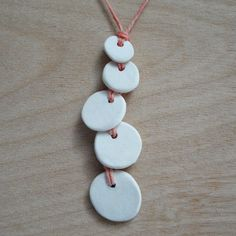 Unglazed porcelain necklace...perhaps I can convince the ceramic artist boyfriend to make me one...or sneak some clay out of his studio and make it myself :)