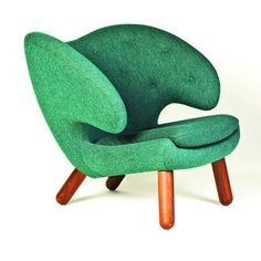 Pelican chair by Finn Juhl, 1940. It was inspired by the sculptor Jean Arp. | green armchair furniture design