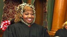 Unreal--.Female Muslim Judge takes Oath while using Koran instead of Bible  John S. Roberts December 13, 2015