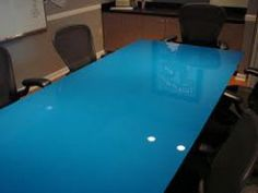 Painted blue table top.  Painted on the underside.