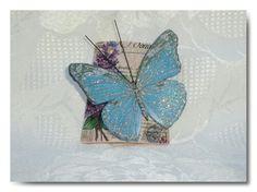 Tegolina con farfalla blu