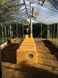 Rocket stove greenhouse - heating with wood in a more energy efficient manner. #greenhousefarming