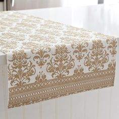A perfect table can't be complete without a Harman Christmas Metallic Baroque Cotton Oversized Table Runner. Beautifully designed in an elegant gold baroque pattern, this holiday decor staple features intricate cut-work details, sure to impress family & friends this holiday season.    Whether you're looking for stocking stuffers, Secret Santa presents, festive Christmas decor or even gift cards, we have a huge selection of unique holiday stuff to make your days and nights merry and bright.