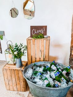 Beer baths and rustic decor with bespoke cheers sign in barn wedding. All by the team at The Little White Cow