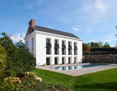 Contemporary take on a traditional house with classical influences by Lynn Morgan Design.
