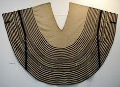 Xhosa ceremonial skirt (umbhaco) with wool braid, mother-of-pearl buttons, and beads, The cut and flare of this large skirt contrast with the Mfengu style. African Fashion Dresses, African Dress, Textile Patterns, Textiles, Coffee To Water Ratio, Xhosa Attire, Black Goddess, Art Costume, Mother Of Pearl Buttons