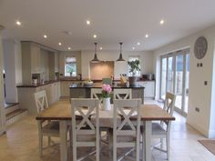 Boldmere House, Shipton Oliffe, rsj builders & Stenvall interiors. Beautiful country Kitchen and dining room in one.  If you like this, why not head on over to http://www.TheHomeDesignSchool.com/signup for more modern country design inspiration, plus get FREE access to our home design resource library.