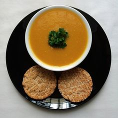 ❝Curried carrot soup served with two rice cakes: you need two peeled and chopped carrots, one chopped celery stick, half an onion, one clove of garlic, half chicken cube (you can use chicken broth or vegetable broth), curry powder & Greek yoghurt (optional), salt & pepper (optional).❞