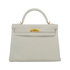 2014 Hermes Kelly Bag  32cm White color Gold Hardware. | From a collection of rare vintage handbags and purses at https://www.1stdibs.com/fashion/accessories/handbags-purses/