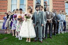 quirky British wedding. Love the floral Wedding dress and colorful maids.
