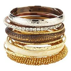 """Bangle Set  $20    It's Banglefest 2011!! Woooooo! This shiny set features eight iron bracelets, each complete with intricate detail. Mix and match and pair with different outfits. What a gem of an idea.  Antiqued gold, antiqued silver  2.5""""W x 2.5""""D  Iron"""