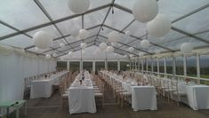 Clear roof with lanterns and long tables. Back wall lined for toilets and kitchen. Clear Marquee, Marquee Hire, Marquee Wedding, Long Tables, Glass Roof, Paper Lanterns, Toilets, Pavilion, Luxury Wedding