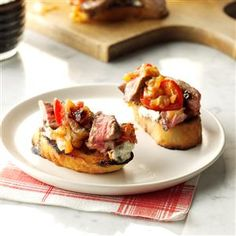 Steak & Blue Cheese Bruschetta with Onion & Roasted Tomato Jam Recipe -An appetizer bursting with flavor from bleu cheese, caramelized onion, jam and balsamic vinegar—tasty bites that vanish in a hurry. —Debbie Reid, Clearwater, Florida