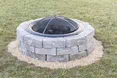 Learn how to make your own outdoor built-in fire pit using paver stones, sand, pea gravel and a steel bowl. The process takes less than two hours to complete!