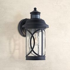 Illuminate your home with this outdoor wall light. Stylish, thanks to handsome Mission-style lines, and practical, with a dusk-to-dawn automatic on-off feature.