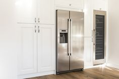 The tall units in this kitchen include a chefs pantry, a wine glass/ wine prep unit and in column Caple wine cooler which serves the needs of guests at the nearby dining table.   #winecooler #kitchendesign #kitchen #mackintoshkitchen #fridgefreezer #kitchenunits #kitchendesigner #interiordesign #kitchendiner