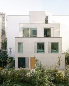 The studio used three stacked cubes to create the form of the building, with each box smaller than the previous to give the design a tapered effect. Terraces were formed on each level by using offset space around the staggered and stepped cubes. Ceiling Windows, Windows And Doors, Terrazzo, Natural Oak Flooring, Modern Townhouse, Social Housing, Building Exterior, Dezeen, Open Plan Living