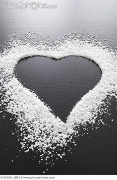 still life of shape of heart made of icing sugar  Website: Google.com  heart is the negative space.