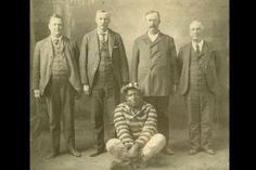 Musician Leadbelly with prison officials, Texas, 1915.
