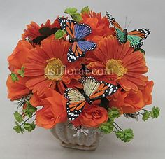 orange gerbera daisy and rose arrangement with butterfly pins to be in beaded vases.