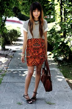 mixed patterns, red toned orange white black pink geometric patterned skirt, striped t-shirt, sandals