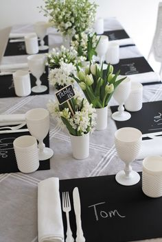 I ABSOLUTELY LOVE THIS!! Table setting by The Design Depot Black or white or gold napkins, garland, and table overlays as well as napkin rings, coasters, and wine covers available at alwayselegant.com