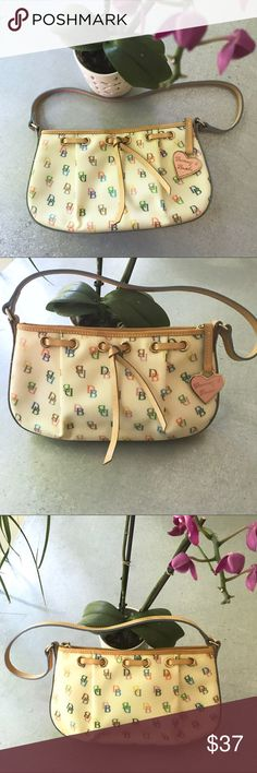 "Dooney & Bourke Shoulder Bag Cute Dooney & Bourke monogram multicolor purse. Very clean inside, with one zippered pocket, a pouch pocket, and a key keeper on a leather cord. This bag has a zipper closure with pink heart zipper pull.  Bag height: 6"", length: 10 1/2"", and depth: 2"". Strap is 21 1/2"" long.  Excellent condition. Dooney & Bourke Bags"