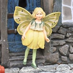 Buttercup Fairy by Fairies. $14.99. scale: 1:12. size: 3x4 inch. material: Resin. Buttercup is the sunniest Flower Fairy(tm) in the meadow. Dressed in radiant yellow petals to add a touch of joy to your miniature fairy gardens.