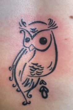 Owl tattoo... kind of looks like its pooping