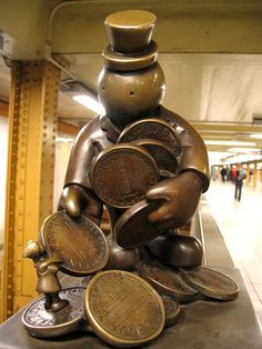 NYC Subway sculpture, but he is also the cutest Monopoly man I have ever seen!!!!  He must be rich, to own the NYC subway and that many pennies.