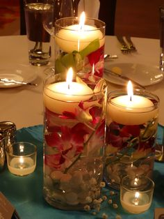 centerpiece- floating candles with fresh orchids