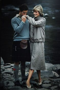 The Prince and Princess of Wales at a photo call on the banks of the river Dee in Scotland while on their extended honeymoon at Balmoral.