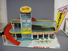 Marx Tin Car City 24 Hour Service Station Playset....I think I had more fun with this toy service station than my brother did......well, maybe not  :)