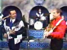 Buck Owens and the Buckeroos - I've Got A Tiger By The Tail.