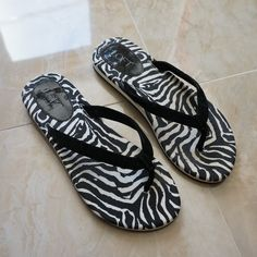 LOFT Zebra Print Flip Flop Worn less than a handful of times. Excellent quality flip flop. Non slip. More elegant design than other flip flops. Look great in the summer and spring paired with shorts, jeans, or dresses! Thicker sole provides more comfort than other flip flops LOFT Shoes Sandals