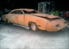 Up in smoke in warehouse fire....69 Dodge Daytona. What a shame!