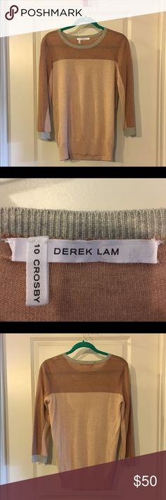 10 Crosby Derek Lamb Light-Weight Sweater This sweater is pre-owned. It comes from a shed-free, smoke-free home. I have only worn this sweater once and it has been dry cleaned once. It is in like-new condition. It is light-weight and can easily be worn as a transition piece from winter to spring. 10 Crosby Derek Lam Sweaters Crew & Scoop Necks