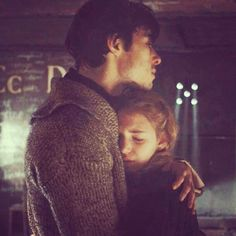 """This picture describes the relationship of Max Vandenburg and Liesel Meminger. They are both broken people, living in a broken world. After they meet, they both realize that they need each other. Even though people say """"opposites attract"""", Liesel and Max are very similar but they attract like metal to a magnet."""