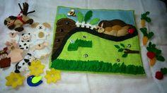 Livro de pano para entreter seu bebê. é um trabalho minucioso, destacável, que fará com que seu filho perca um pouco de tempo tentando montar novamente as páginas, com animais, flores, cores etc