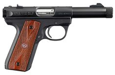 Ruger 22/45~ classic piece, for when there is only time to shoot from the hip and ask questions later.  (But Beretta is better, shh!)